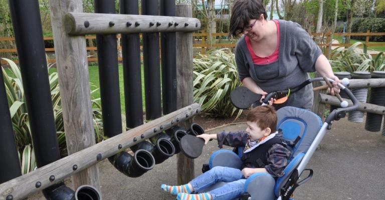 Malachi in the sensory garden at Acorns